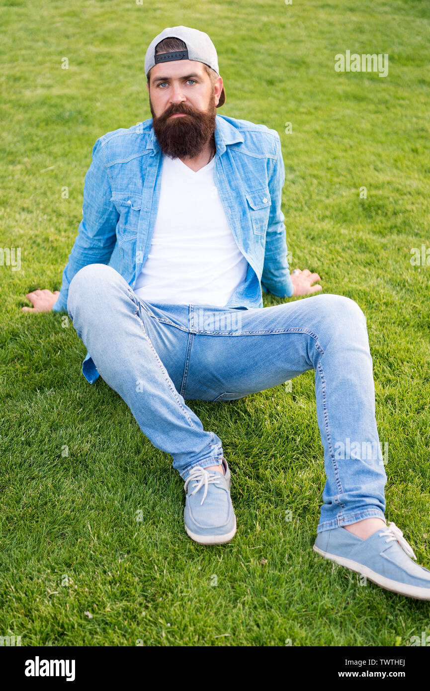 Brutal Handsome Hipster Man Resting On Summer Day Bearded Man Trendy Hipster Style Guy Modern Outfit Casual And Comfortable Hipster Lifestyle Cool Hipster With Beard Wear Stylish Baseball Cap Stock Photo