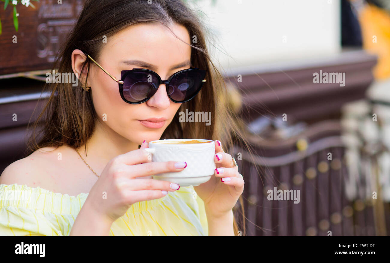 good morning. Breakfast time. stylish woman in glasses drink coffee. girl relax in cafe. Business lunch. morning coffee. Waiting for date. summer fashion. Meeting in cafe. Her perfect breakfast. Stock Photo