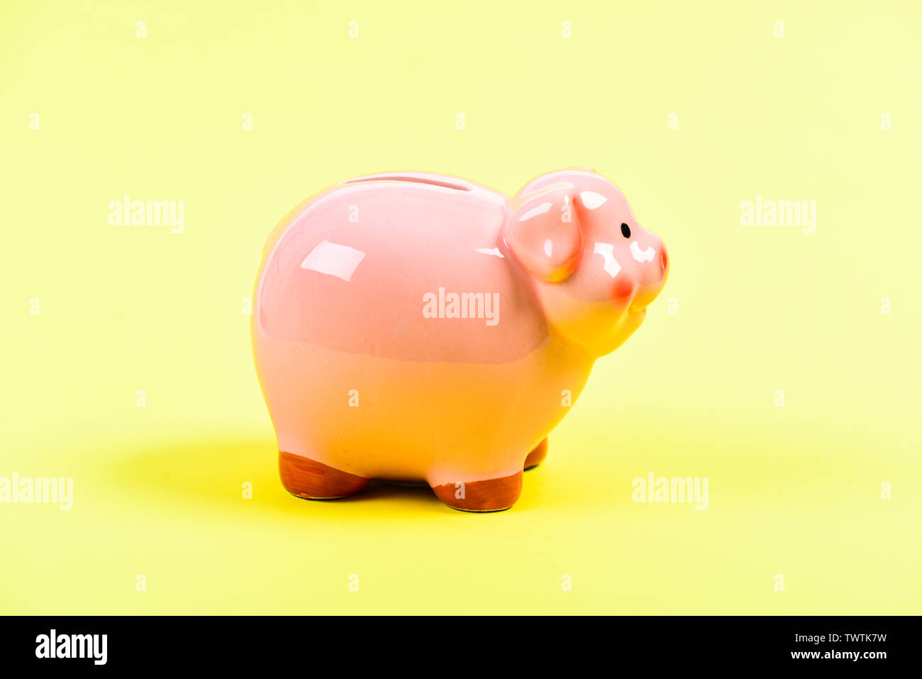 planning budget. financial problem. money saving. income management. piggy bank on yellow background. Time save Concept. Moneybox for coins with pig face. No to bribing. bribe. - Stock Image