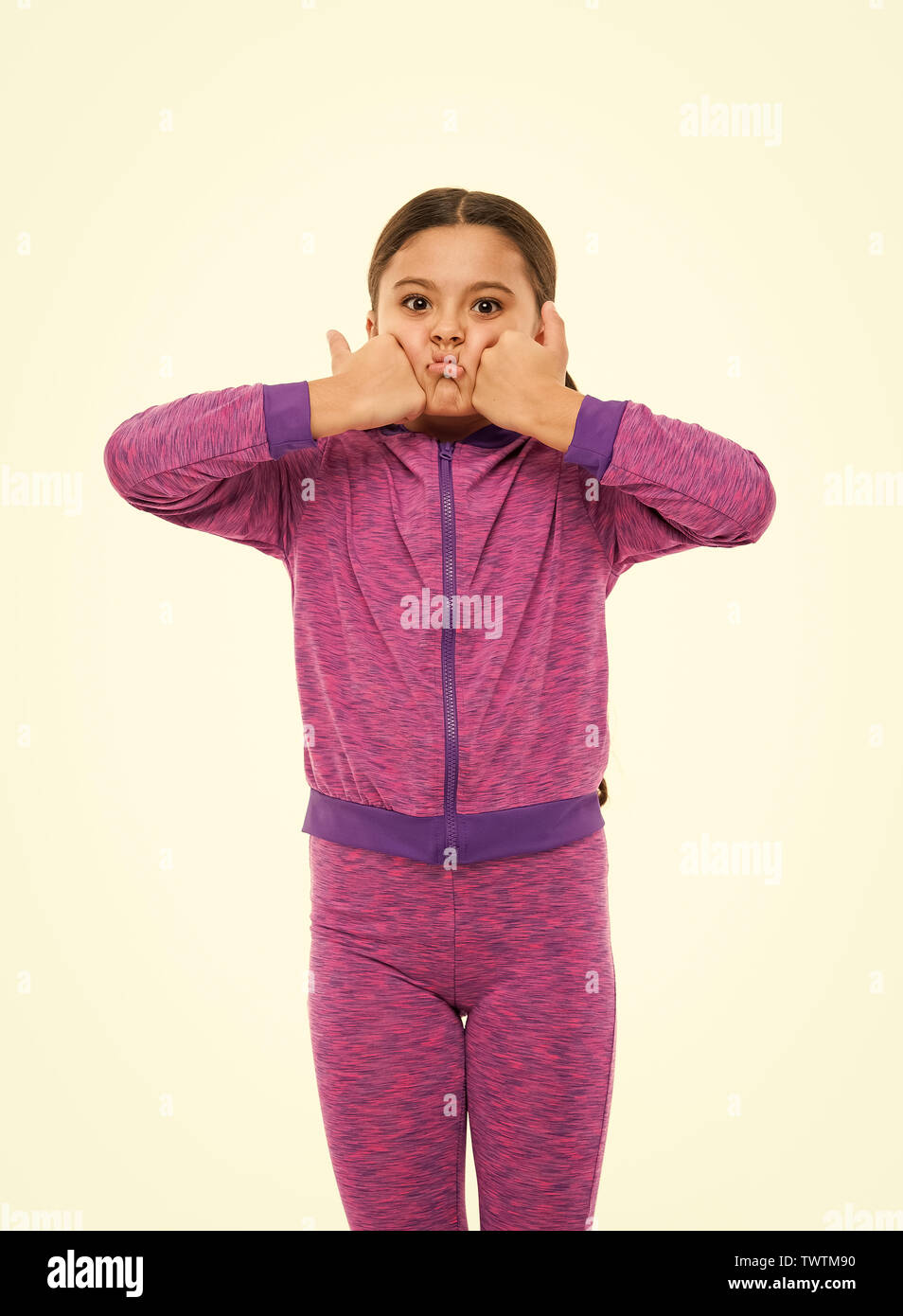 This is awesome. Kid show thumbs up. Girl happy totally in love fond of or highly recommend. Thumbs up approvement. Girl cute child show thumbs up gesture. Gifts your teens will totally love. - Stock Image