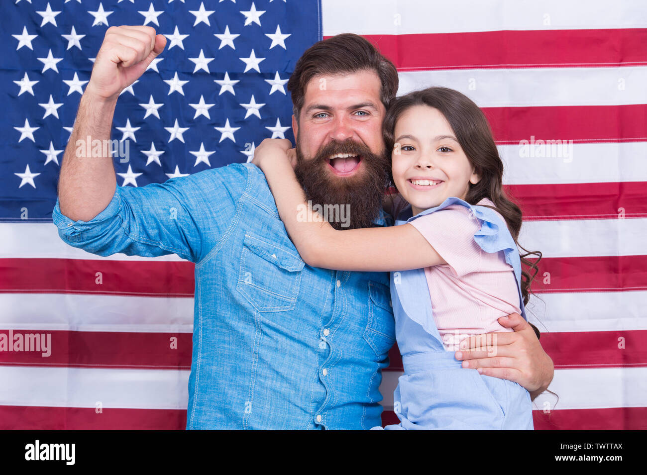 Freedom fundamental right. How do americans celebrate independence day. Father american bearded hipster and cute little daughter with USA flag. Independence is happiness. Independence day holiday. - Stock Image
