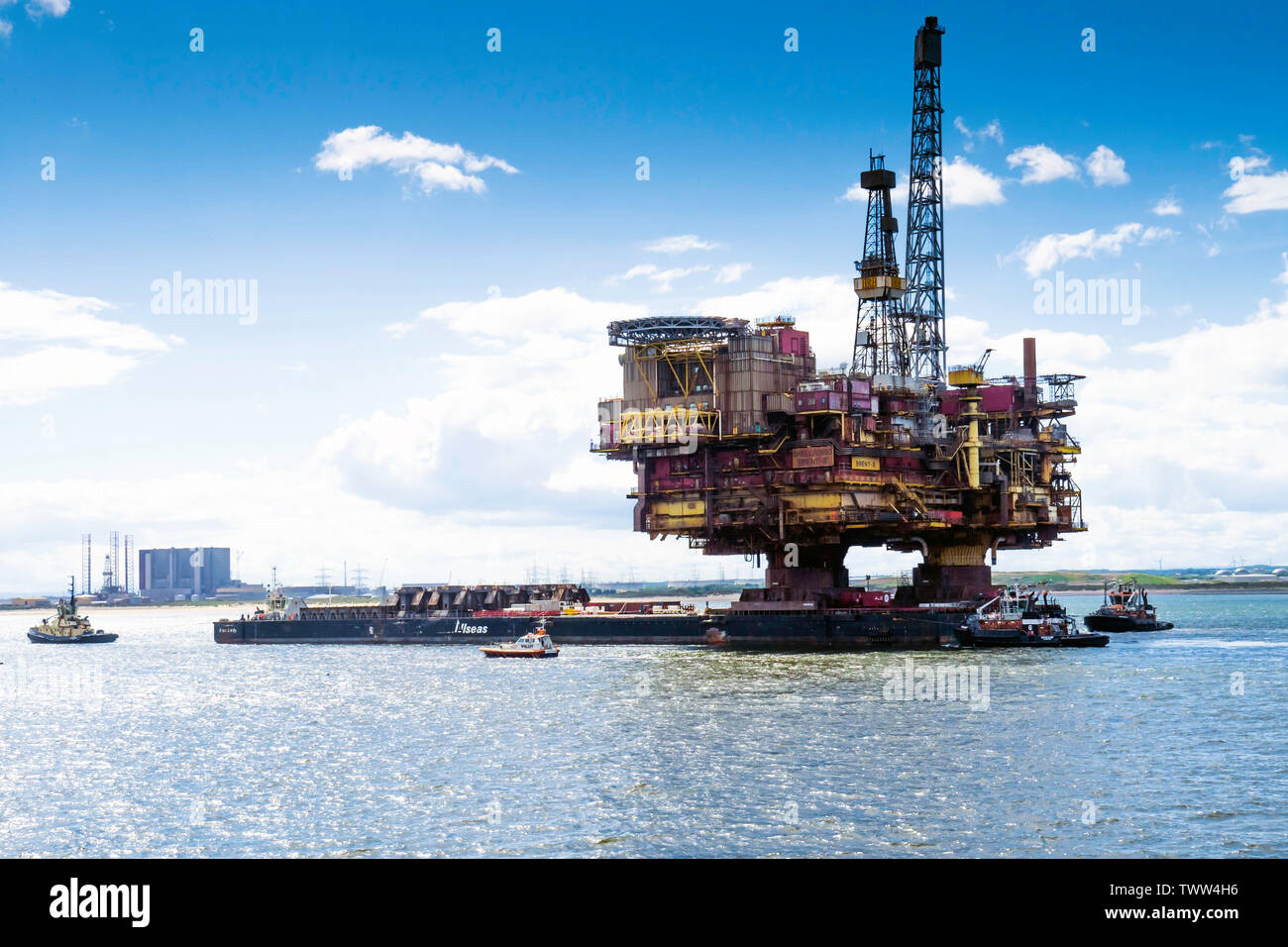 The topside of the Shell/Esso Brent Bravo platform arriving in the River Tees for recycling after 40 years service in the Northern North Sea - Stock Image
