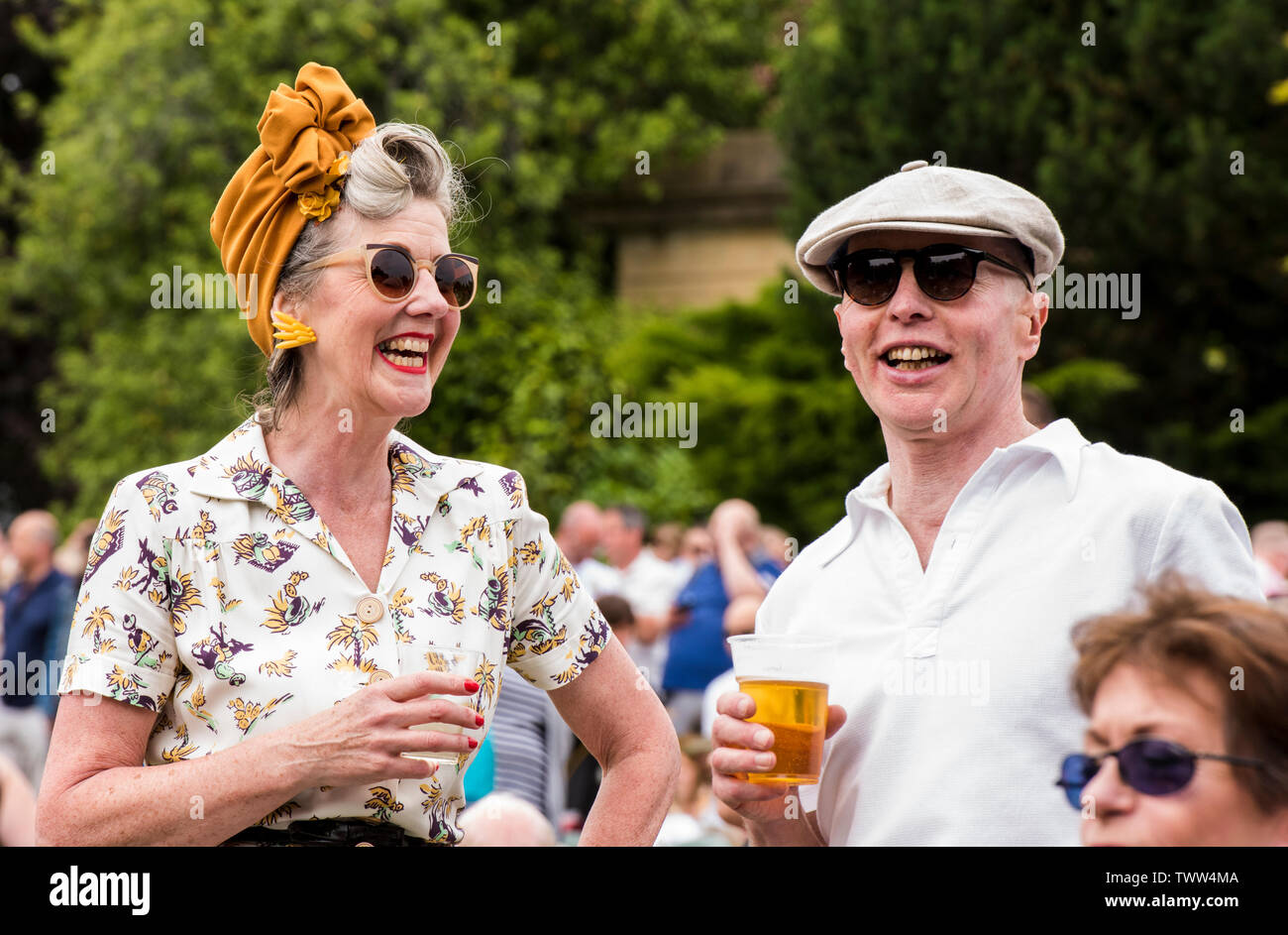 Couple wearing 1940s clothing in Valley Gardens on 1940s Day, Harrogate, England, UK, 23rd June 2019. Stock Photo