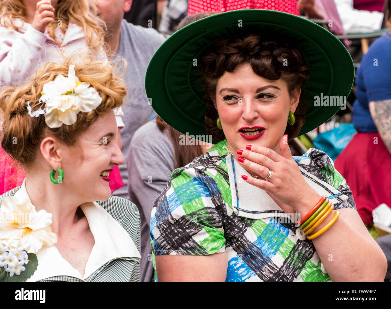 Women wearing 1940s style clothing in Valley Gardens on 1940s Day, Harrogate, England, UK, 23rd June 2019. Stock Photo