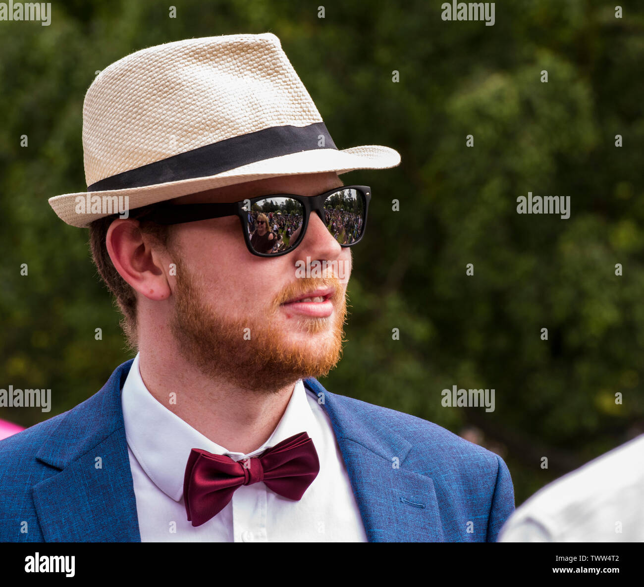 Man wearing trilby hat and sunglasses in Valley Gardens on 1940s Day, Harrogate, England, UK, 23rd June 2019. Stock Photo