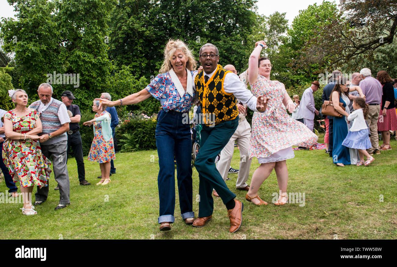 Energetic couple dancing and having fun on 1940s Day, Harrogate, England, UK, 23rd June 2019. Stock Photo