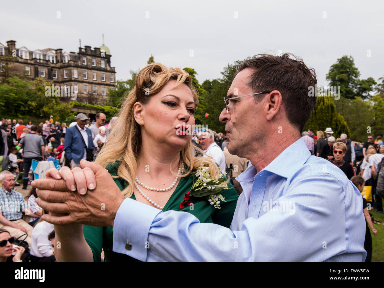 Couple dancing with woman pouting on 1940s Day, Harrogate, England, UK, 23rd June 2019. Stock Photo