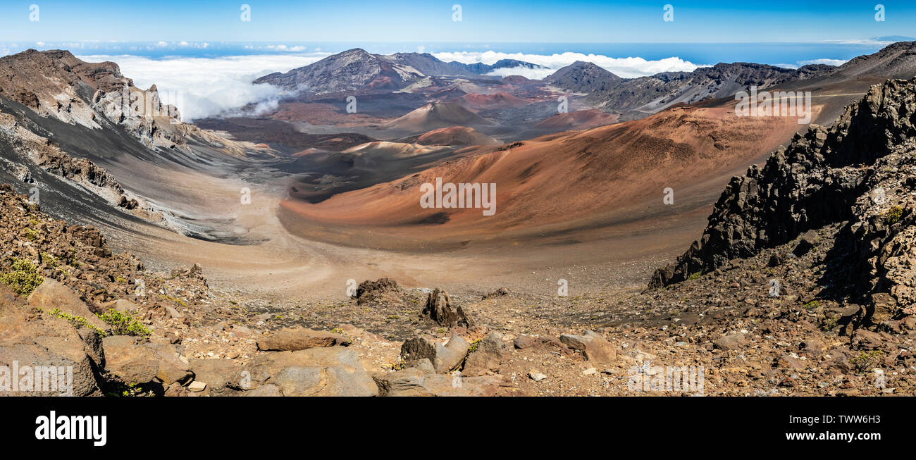 Gorgeous view of the Haleakala Crater in Haleakala National Park, showing various forms of geology and the clouds rolling in. Maui, Hawaii, USA Stock Photo