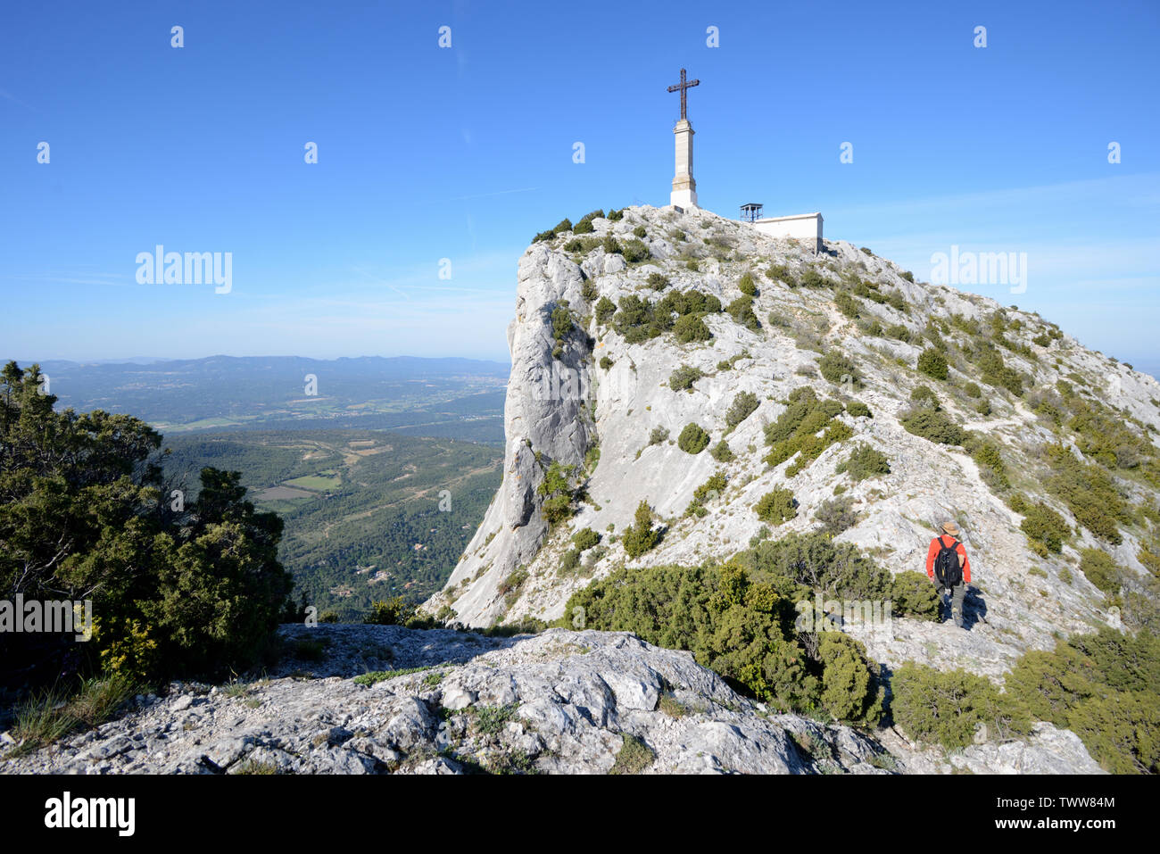 Walker near the Summit of Mont or Montagne Sainte-Victoire Mountain Aix-en-Provence Provence France - Stock Image