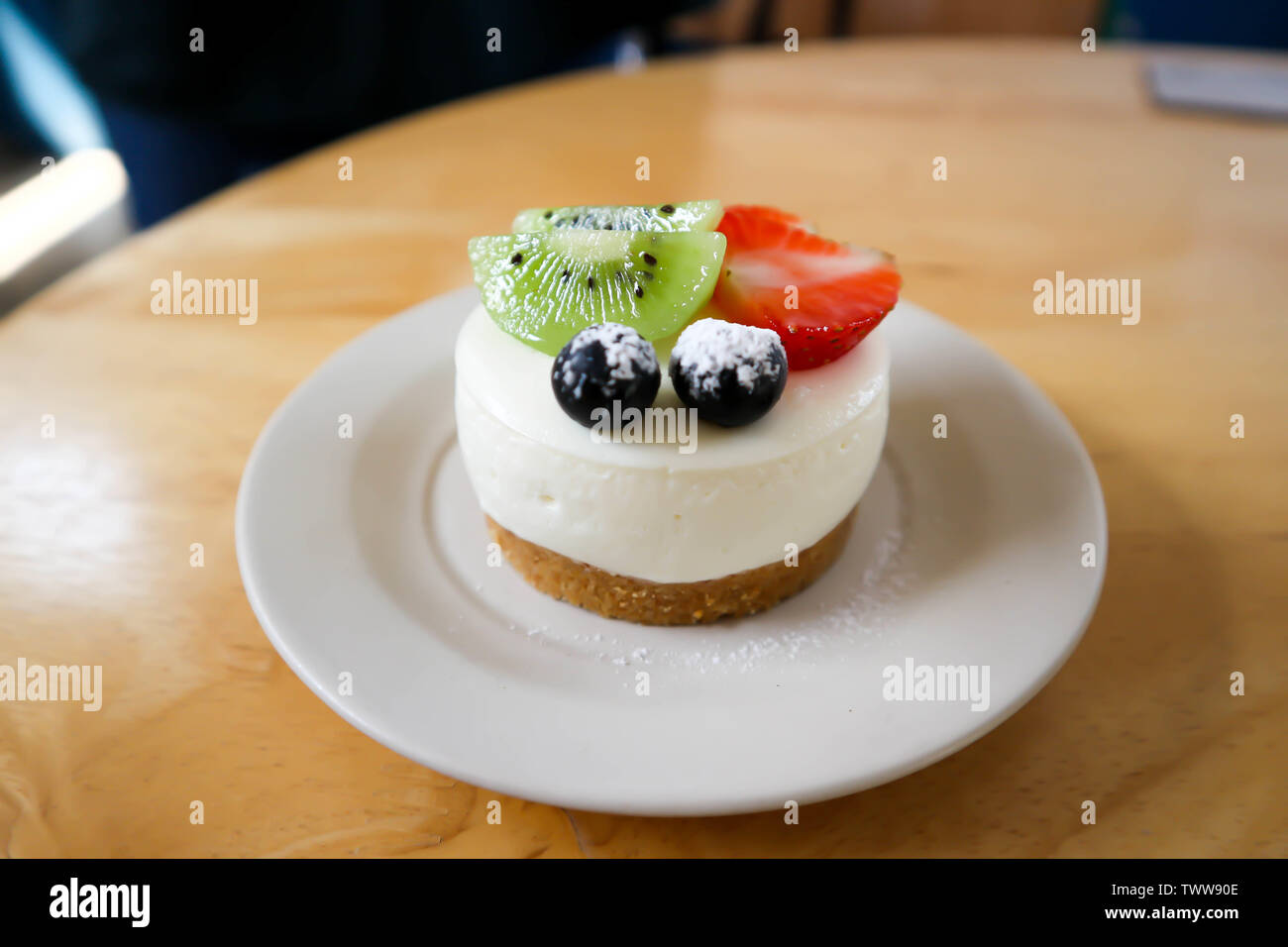 fruit cake or cheese cake with fruit topping - Stock Image