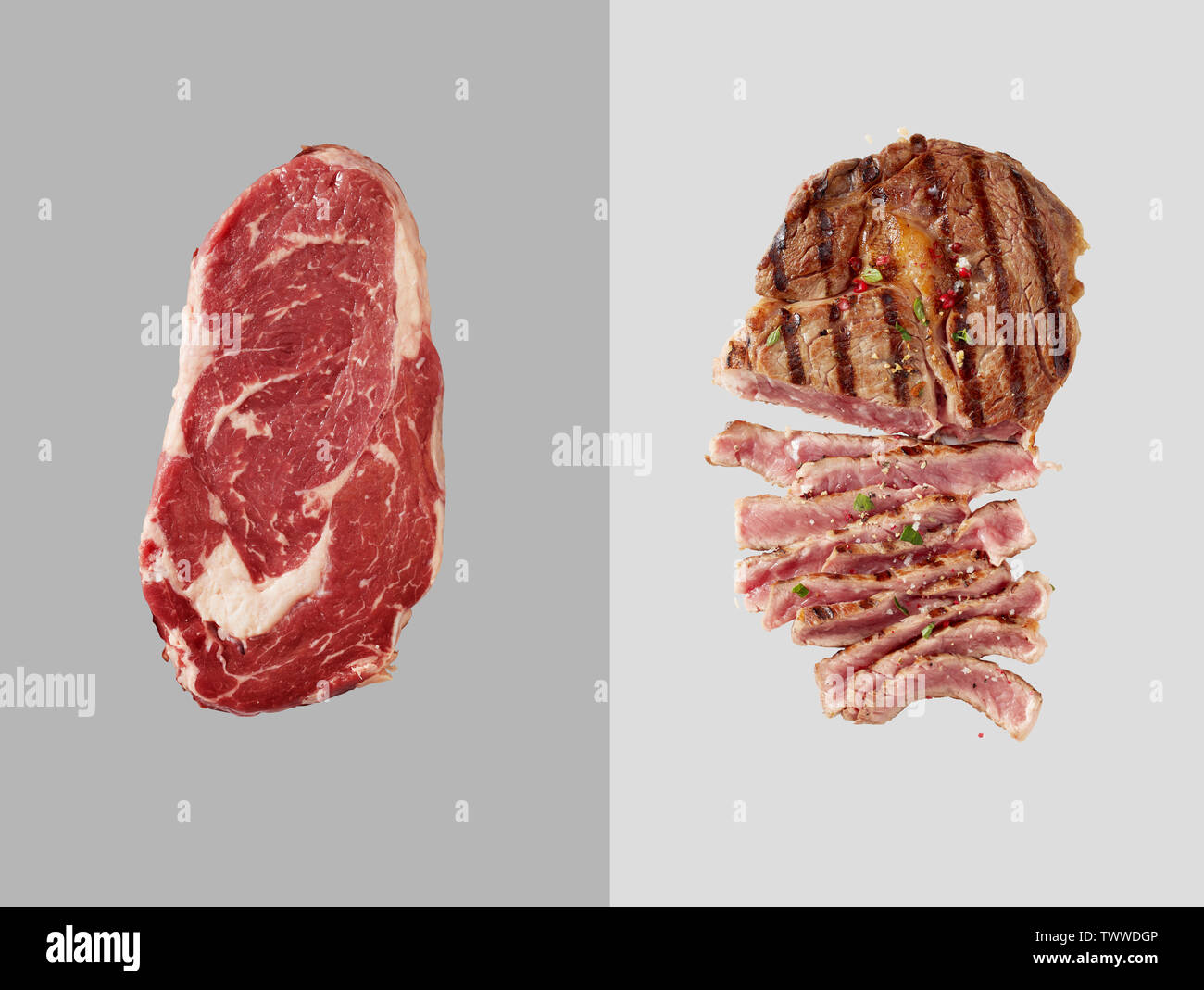 Chunk of uncooked beef over grey backdrop next to cooked beef with several slices cut out over light grey backdrop - Stock Image