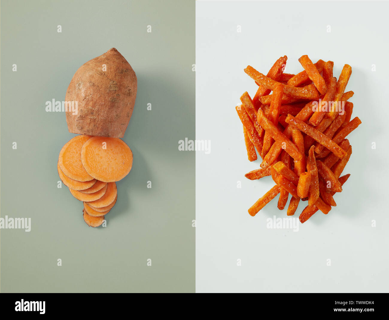 Single sliced sweet potato next to small pile of sweet potato fries on top of two tone grey background - Stock Image