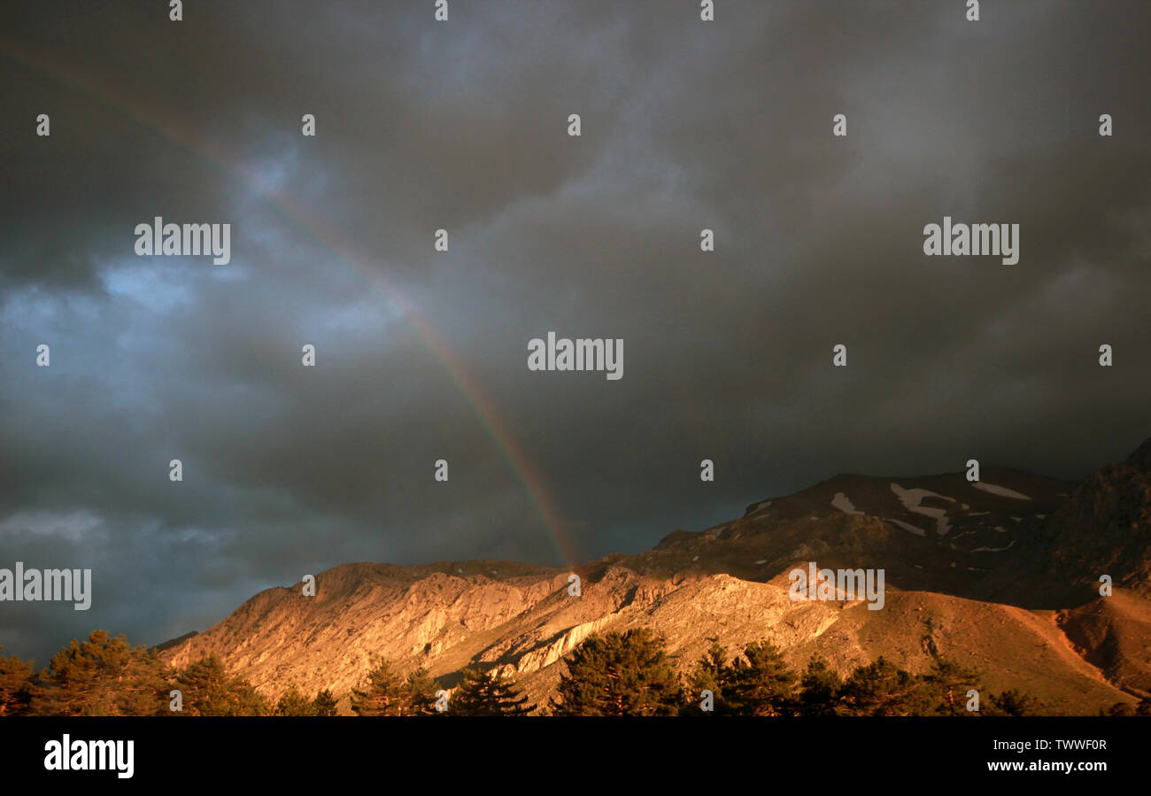 cloudy sky and rainbow after rain - Stock Image