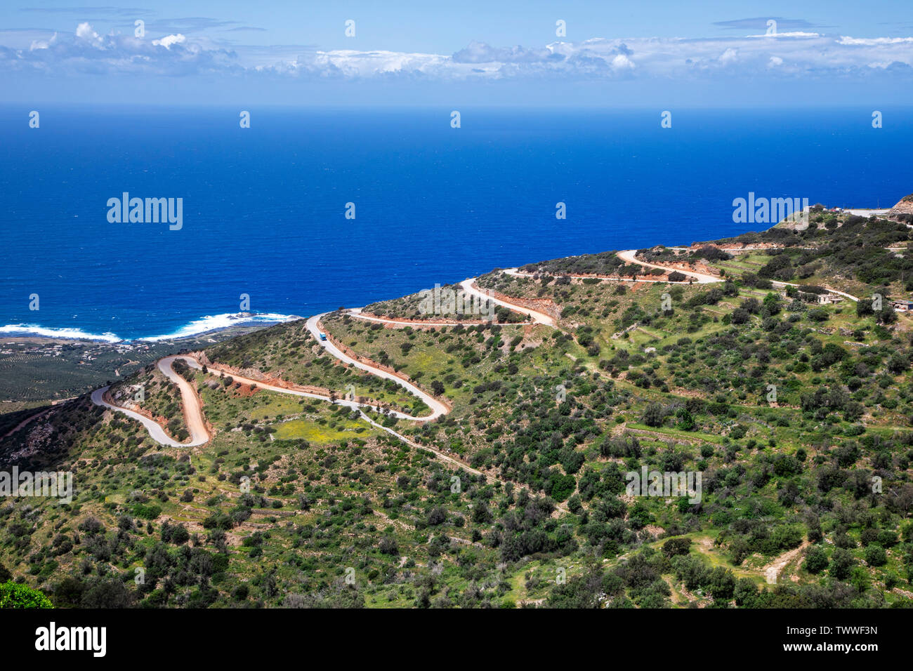 A long twisting road out of the mountains leads to the western coast of Crete, Greece. - Stock Image