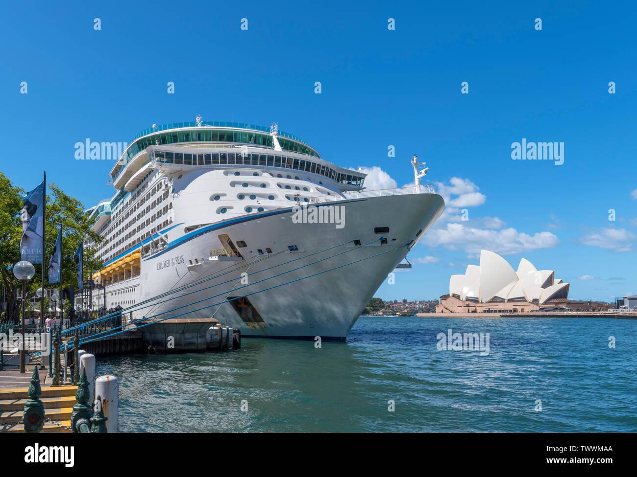 Explorer of the Seas cruise ship at Circular Quay with Sydney Opera House behind, Sydney, Australia - Stock Image