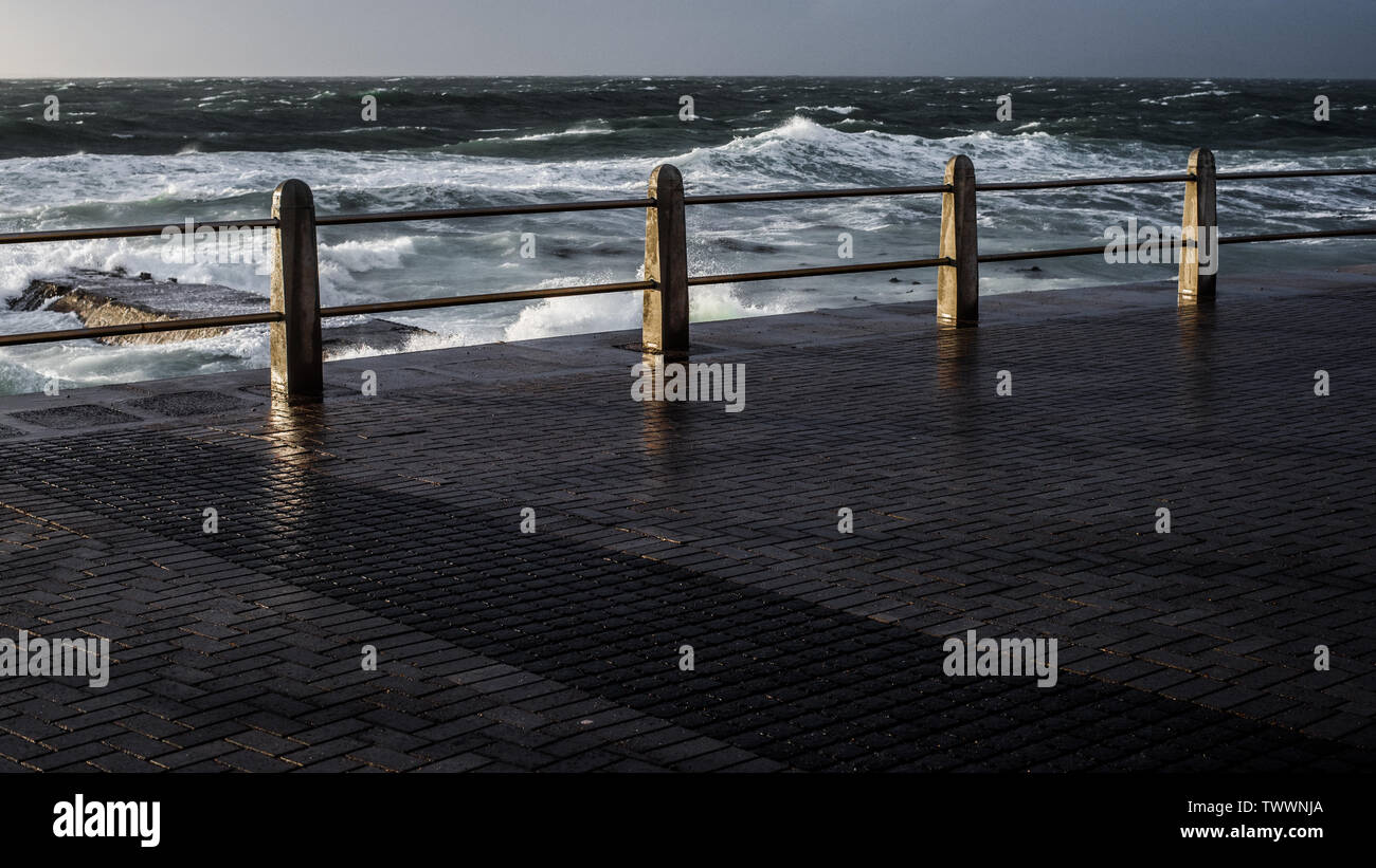 The Seapoint Promenade in the South African city of Cape Town during the winter months - Stock Image