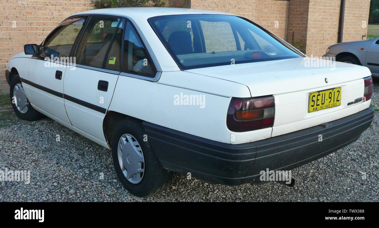 """English: 1990 Toyota Lexcen (T1) sedan (with 1998–1999 Mitsubishi Lancer (CE II) hubcaps). Photographed in Woronora, New South Wales, Australia.; 19 June 2009; Own work; OSX; "" Stock Photo"