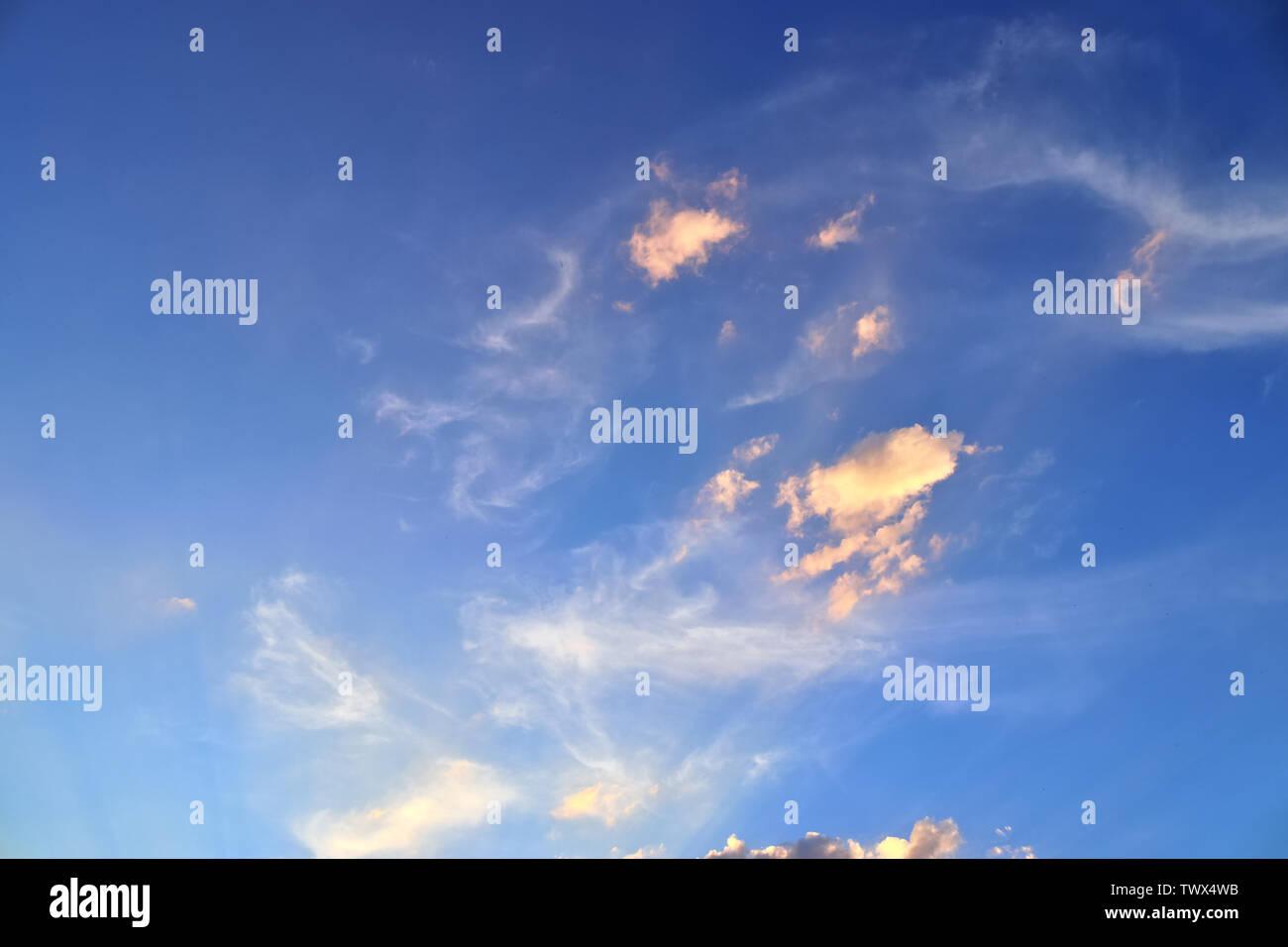Beautiful orange sunset cloud formations with sunlight shining through - Stock Image