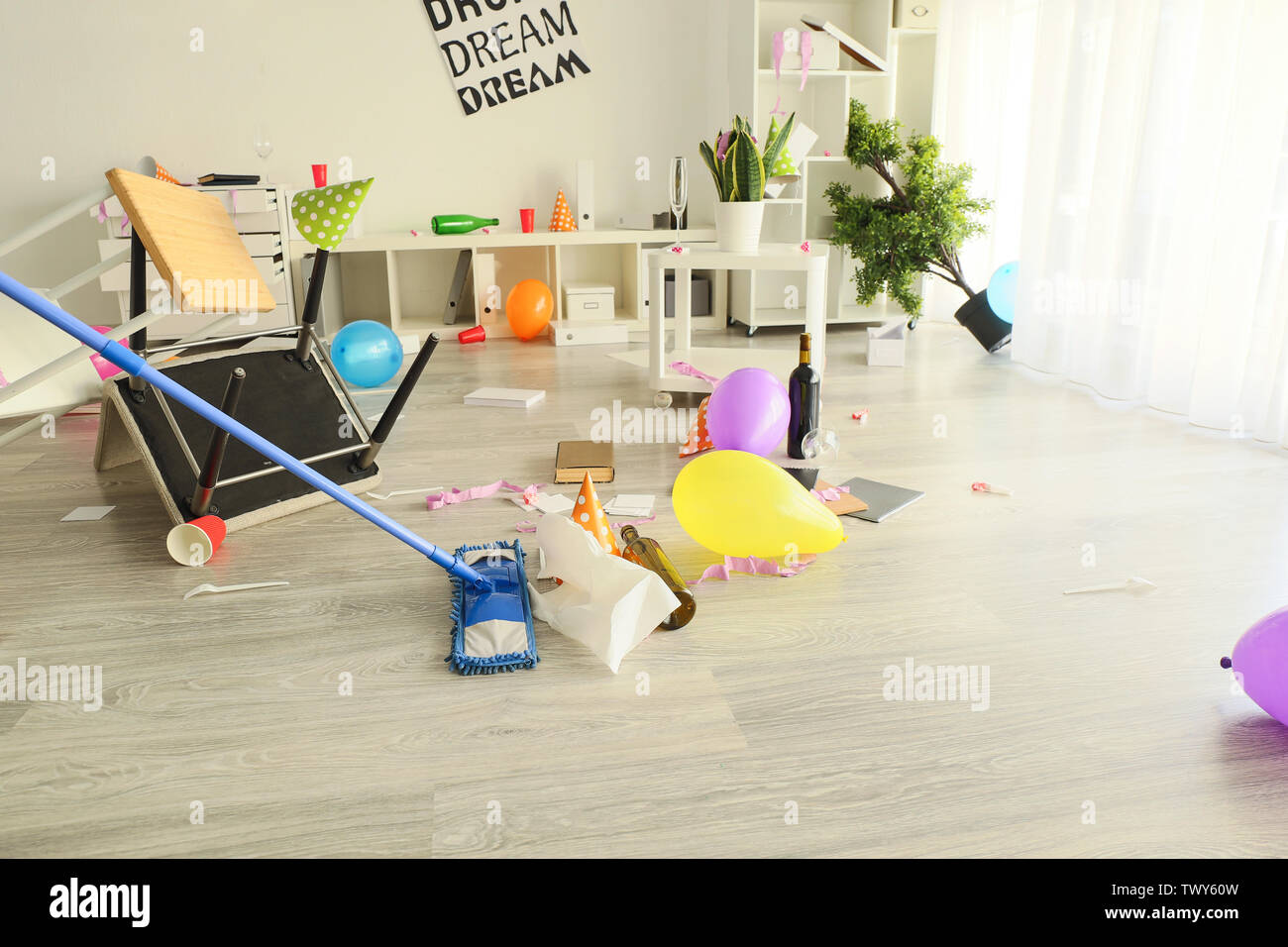 Cleaning of office after party - Stock Image