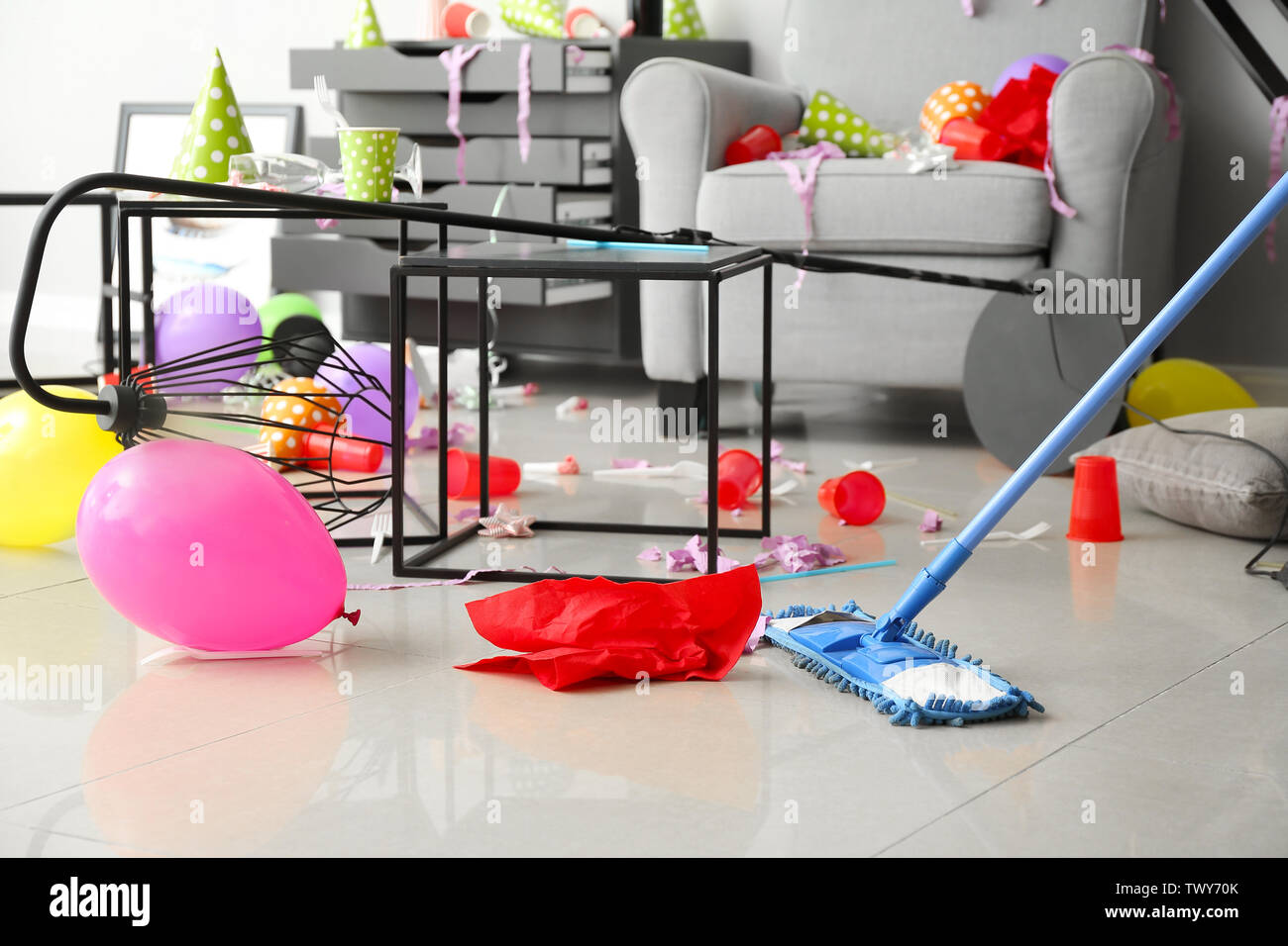 Cleaning of floor in room after party - Stock Image