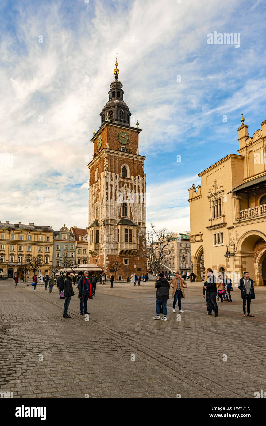 Cracow, Poland - Feb 2, 2019: Tourists visiting Main Market Square and Town Hall Tower in Cracow, Poland - Stock Image