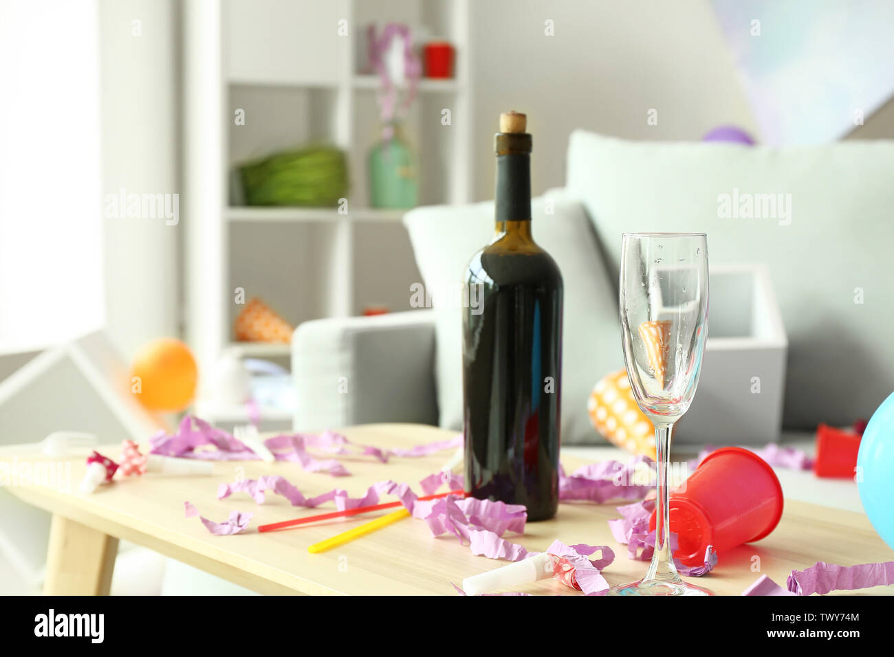 Table with trash in room after party - Stock Image