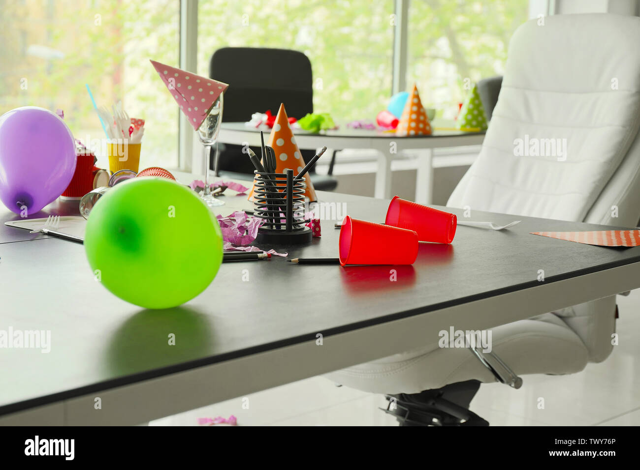 Table with trash in office after party - Stock Image