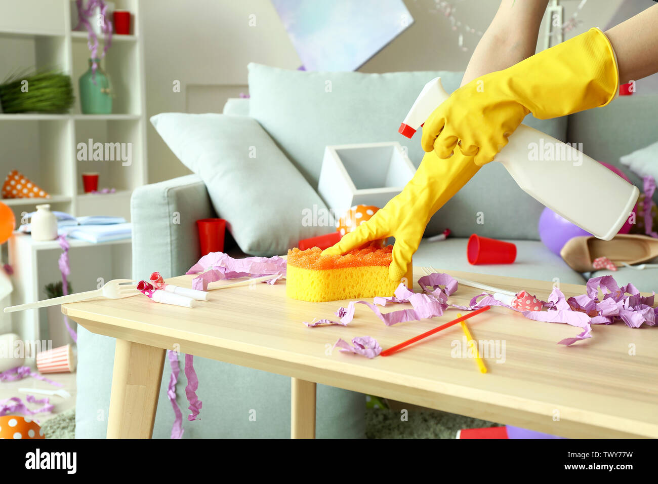 Janitor cleaning room after party - Stock Image