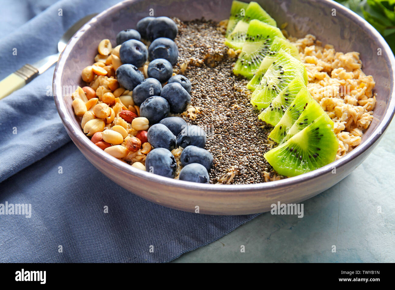Bowl with tasty chia dessert on table - Stock Image