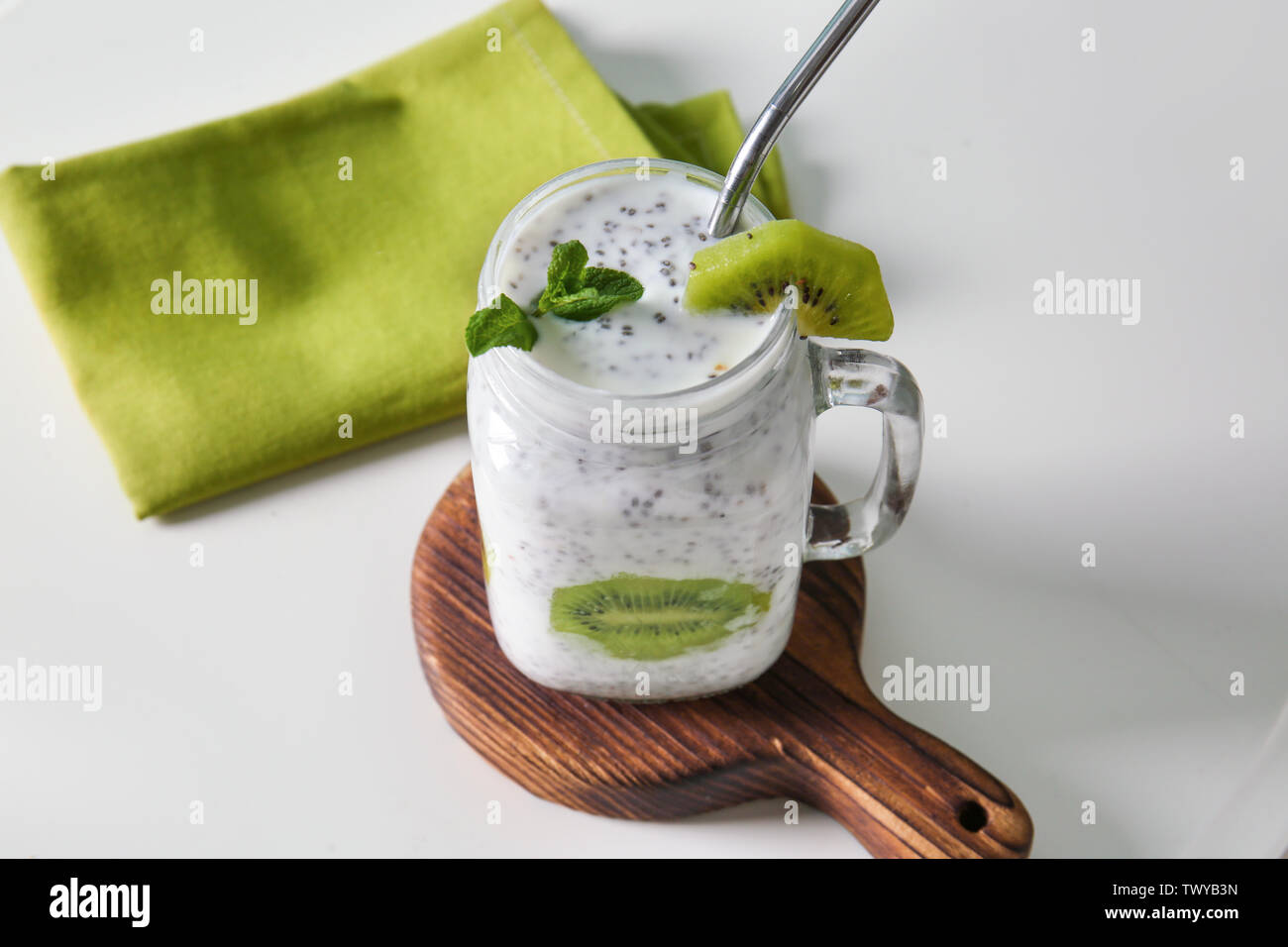 Mason jar of tasty chia cocktail on table - Stock Image