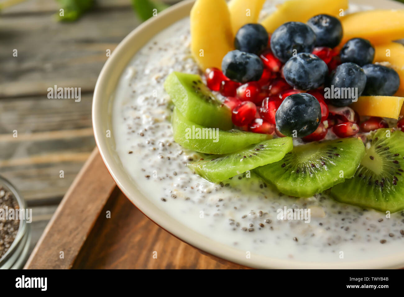 Bowl with tasty chia dessert on table, closeup - Stock Image