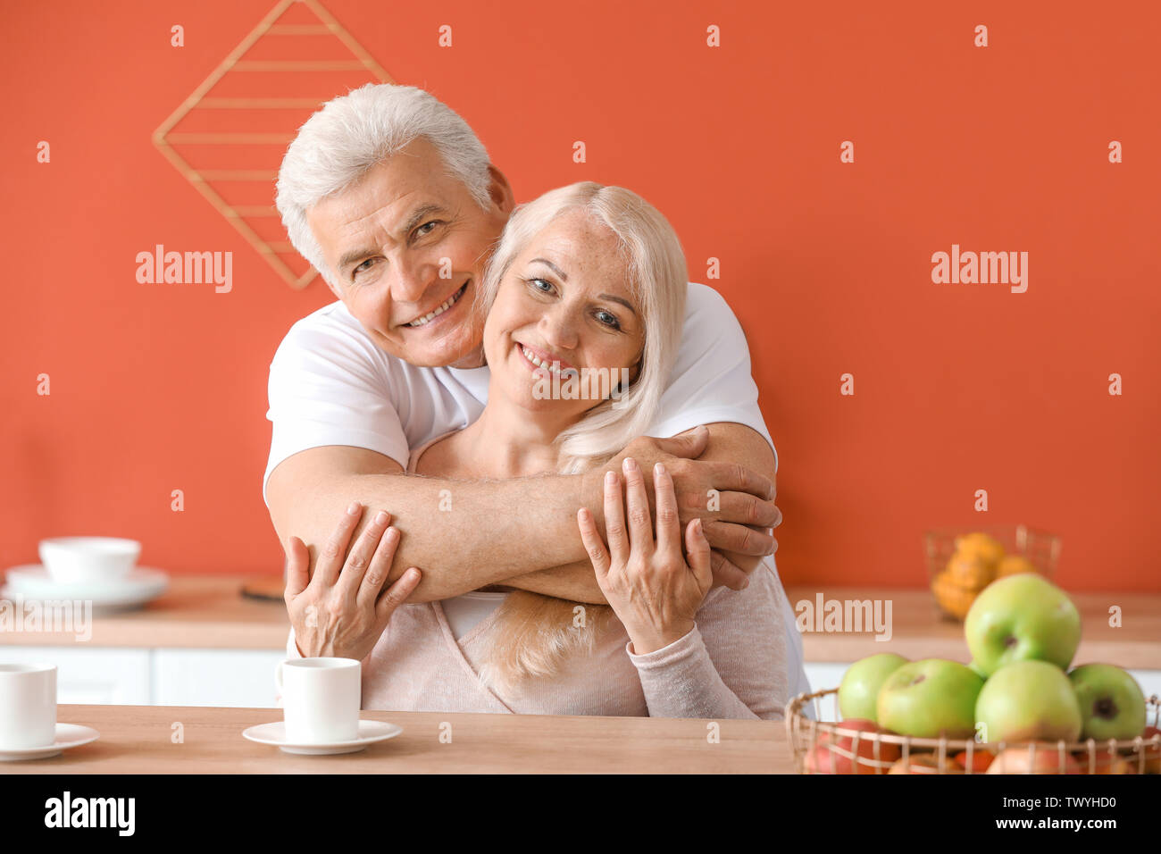 Portrait of happy mature couple at home - Stock Image