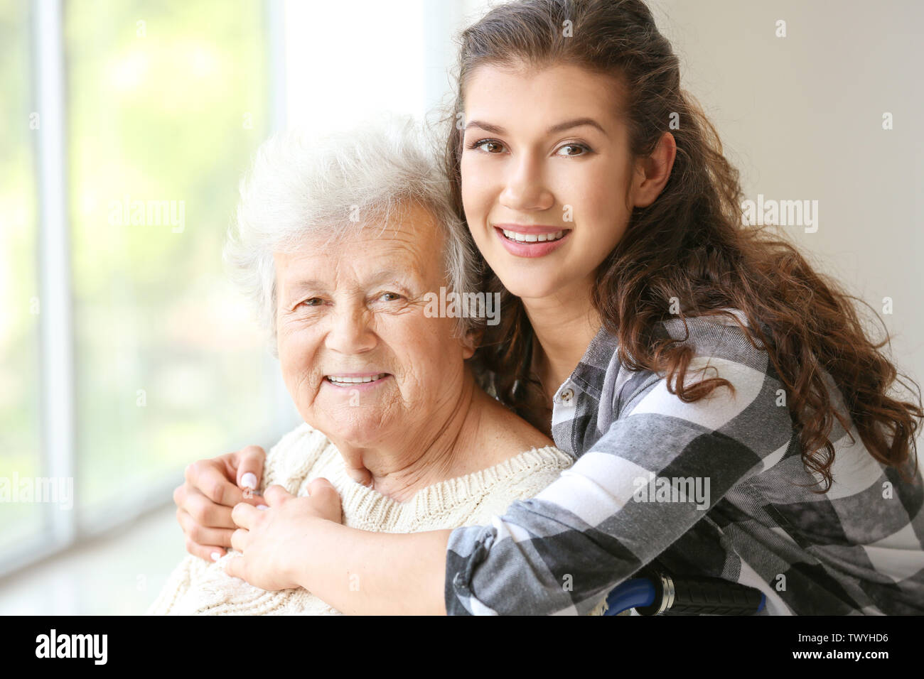 Senior woman with her granddaughter in nursing home - Stock Image