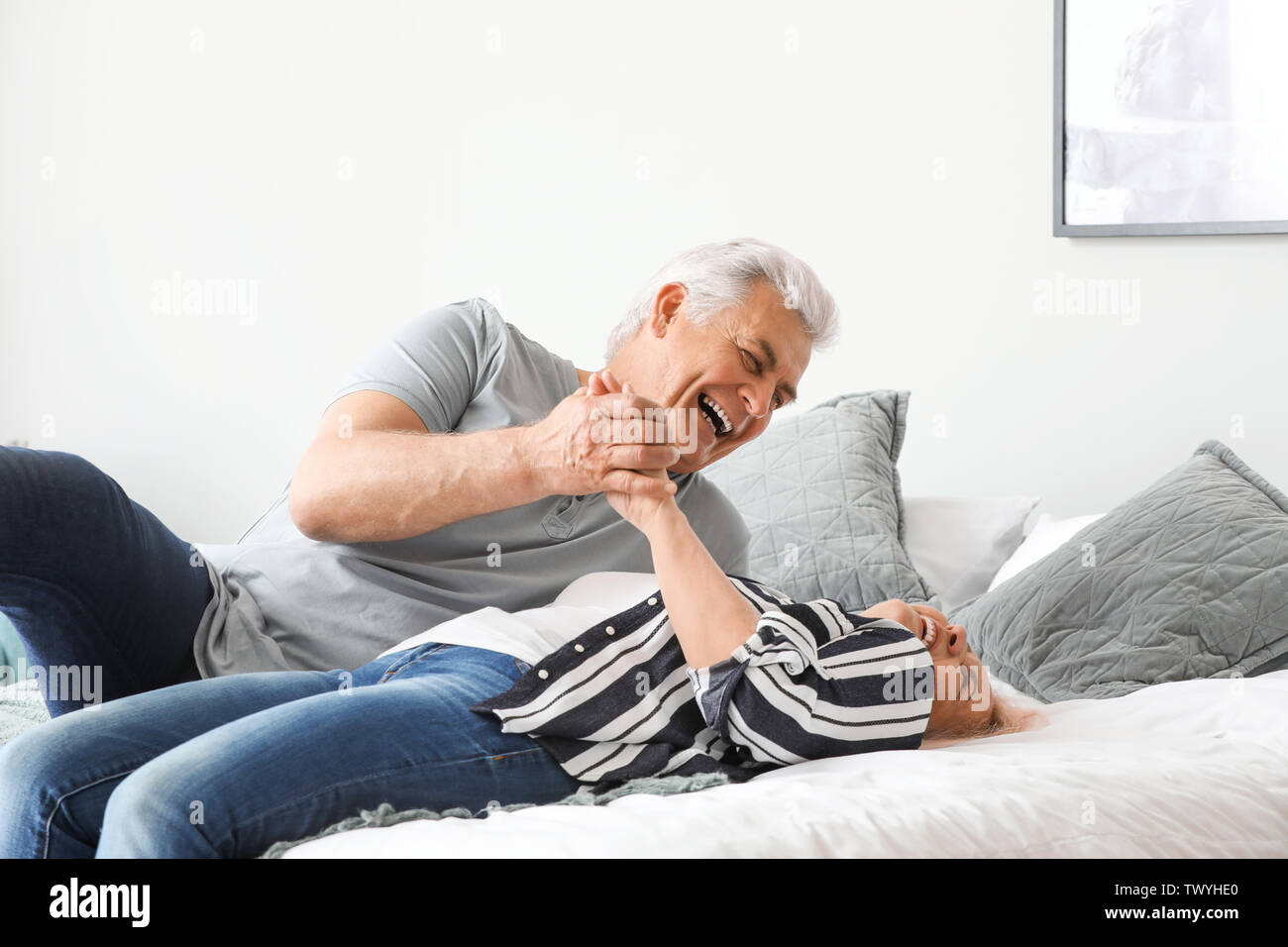 Portrait of mature couple having fun at home - Stock Image