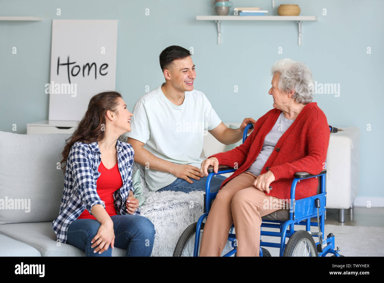 Senior woman with her grandchildren at home - Stock Image