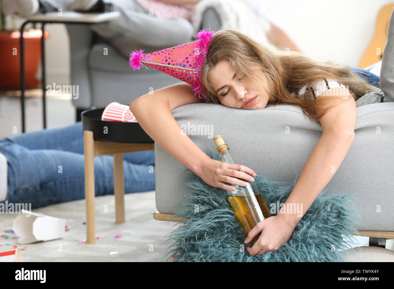 Young woman sleeping after party at home - Stock Image
