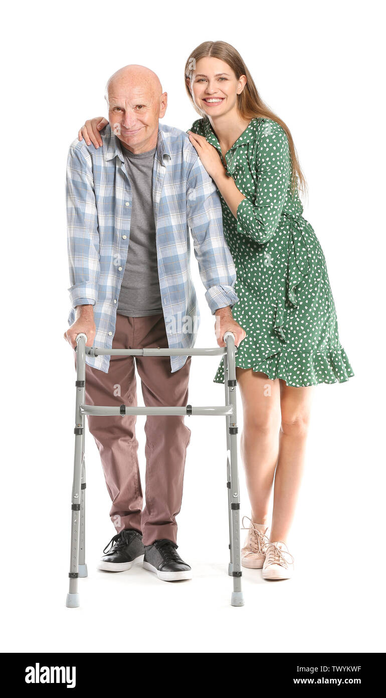 Elderly man with daughter on white background - Stock Image