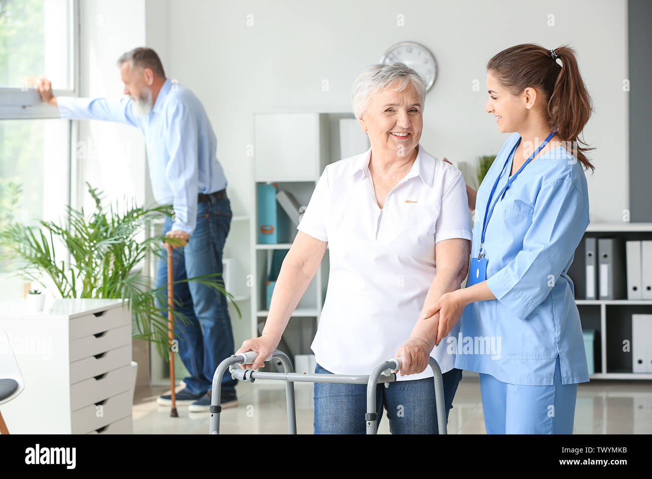 Elderly Woman With Caregiver In Nursing Home Stock Photo Alamy