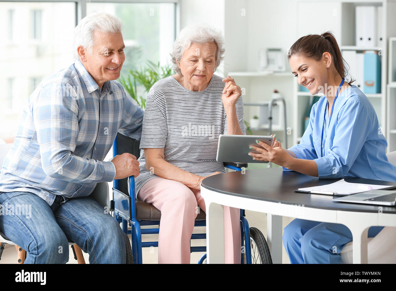 Elderly People With Caregiver In Nursing Home Stock Photo Alamy