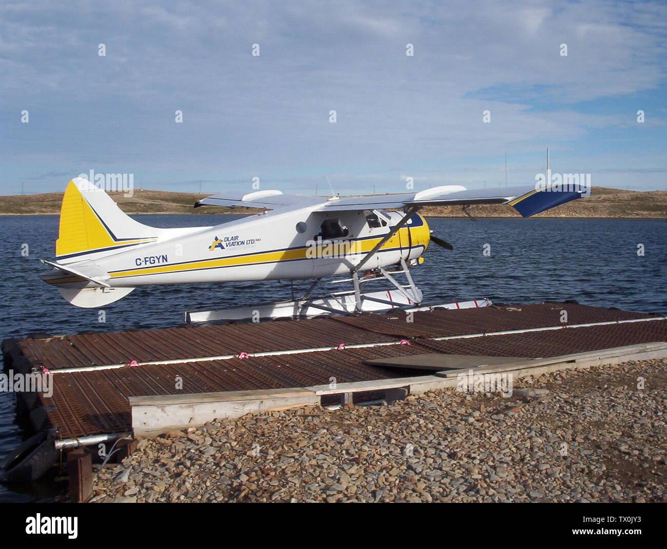 'English: C-FGYN Adlair Aviation Ltd. de Havilland Beaver (DHC2) Mk.I, at the Adlair Float Base, Cambridge Bay, Nunavut, Canada.; 31 July 2005, 17:10; Own work; CambridgeBayWeather; ' - Stock Image