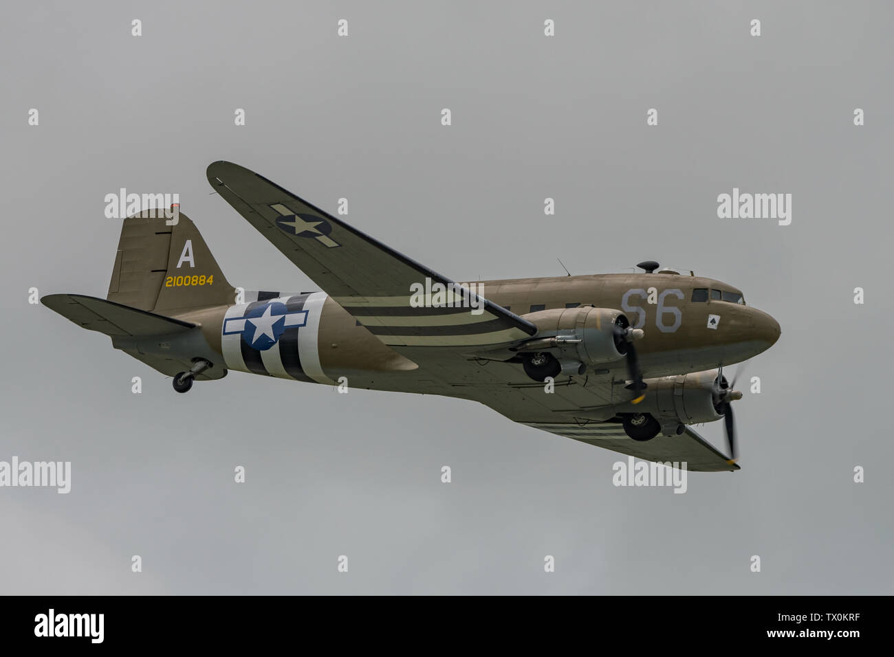 A Douglas C-47 Skytrain WW2 transport aircraft in the sky above Dunsfold Aerodrome, UK for the last ever Wings & Wheels airshow on the 16th June 2019. - Stock Image
