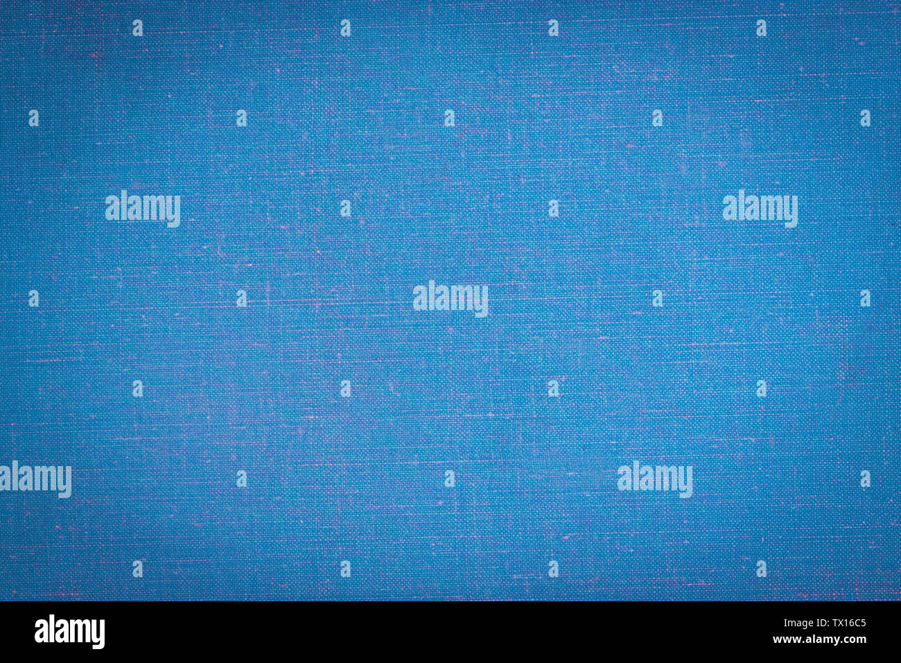 A vintage cloth book cover with a blue screen pattern, grunge background textures. - Stock Image