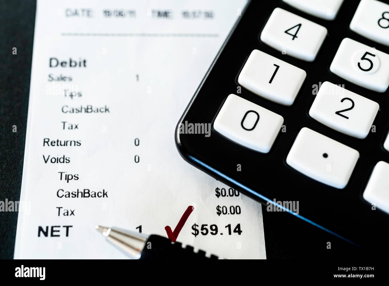 Reconciling Credit Card batch report with receipts at end of the day - Stock Image