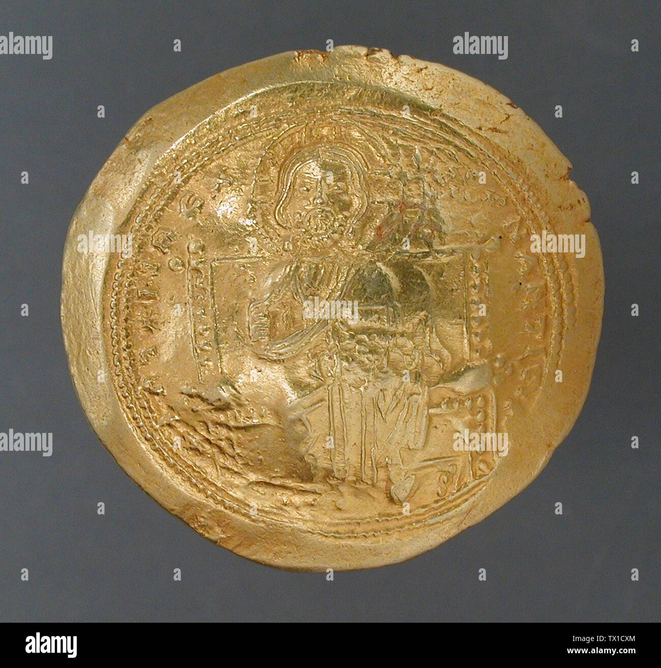 'Coin, Isaac I Commenus (image 1 of 2); English:  Constantinople, Byzantine, circa 1057-1059 A.D. Tools and Equipment; coins Gold Diameter: 1 1/16 in. (2.6 cm) Museum Associates Acquisition Fund (M.82.15.6) Art of the Ancient Near East; between circa 1057 and circa 1059 date QS:P571,+1057-00-00T00:00:00Z/8,P1319,+1057-00-00T00:00:00Z/9,P1326,+1059-00-00T00:00:00Z/9,P1480,Q5727902 A.D.; ' - Stock Image