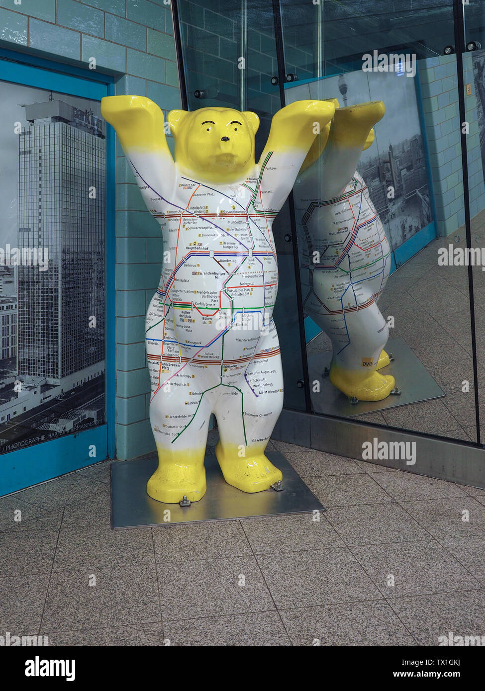 BERLIN, GERMANY - CIRCA JUNE 2019: bear, symbol of the city of Berlin, with U-bahn map Stock Photo