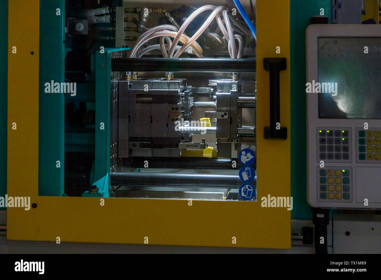 DUBAI, UAE, JANUARY 09, 2019: Process of forming bricks Lego using the plastic injection molding machine in Legoland - Stock Image