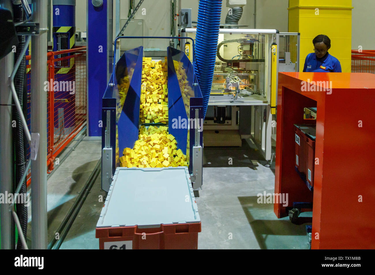 DUBAI, UAE, JANUARY 09, 2019: Technological process of creating Lego bricks in Legoland. Many yellow bricks Lego are ready to packing - Stock Image