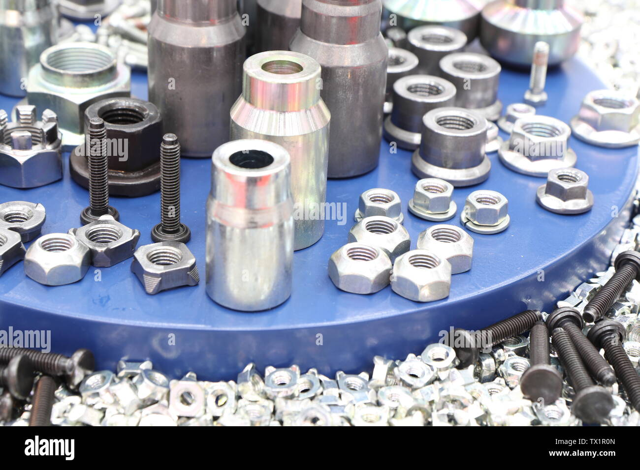 small bolts and nuts by manufacturing process ; tapping - Stock Image