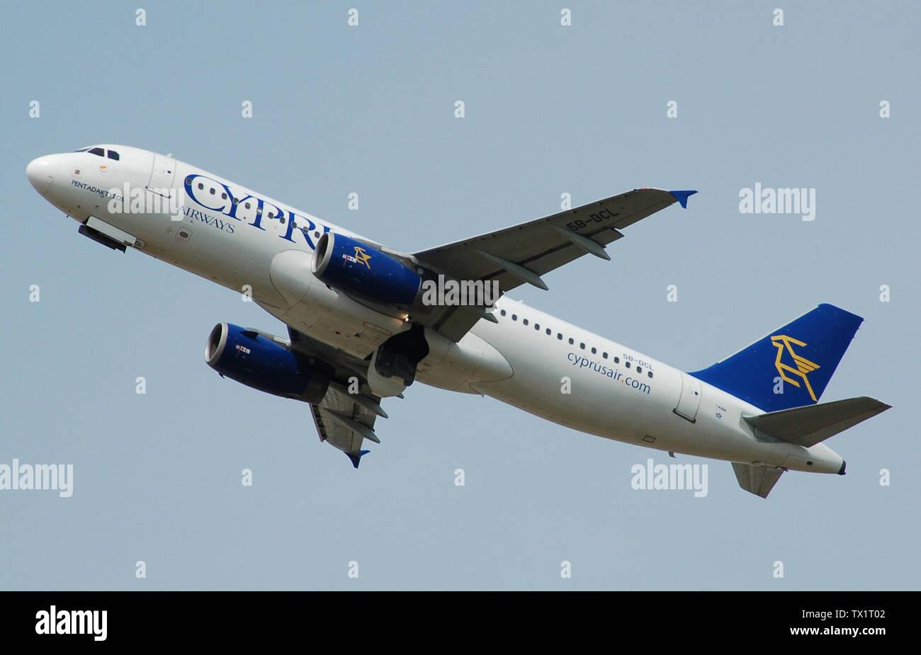 'Cyprus Airways Airbus A320-200 (5B-DCL) departs London Heathrow Airport, England, 2nd July 2014. The undercarriage doors are yet to close.; Taken on 2 July 2014; My own photograph, taken with a Nikon D50 DSLR and a Nikon 18-200 mm lens.; Myself (Adrian Pingstone).; ' - Stock Image