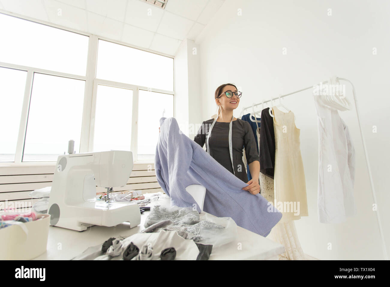 Dressmaker Fashion Designer And Tailor Concept Talented Young Designer Choosing Clothing For New Future Collection Standing In Own Showroom Stock Photo Alamy